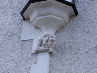 Gargoyle to base of turret, east elevation