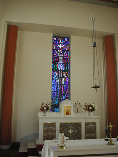 Detail of stained glass window to chancel gable.