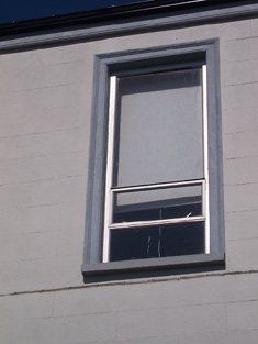 Detail of first floor window surround.