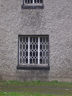 Detail of window with lattice glazing.