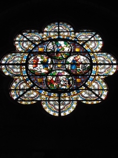"View of Hall-Dare Memorial ""Rose Window"" supplied (1877) by Horatio Walter Lonsdale (1844-1919) of Saunders and Company (fl. 1869-80) of London to a design by William Burges (1827-81) depicting ""The Parable of the Good Samaritan""."