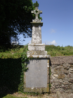 "View of lichen-covered drag edged cut-limestone marker dedicated: ""The Burial Place Of/BENJ & ANN CONN/Of BALLYHACK/His MOTHER/Died June ???? Aged 72/???? [remainder illegible]""."