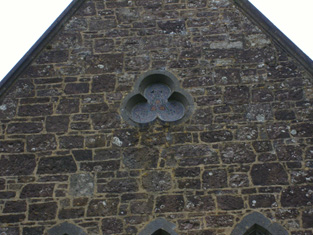 Trefoil window to south.
