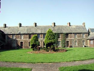 View of courtyard (north-east) elevation of perpendicular wing to south-west.