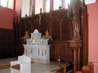 View of altar furniture and reredos.