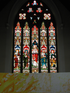 "View of Ronayne Memorial ""East Window"" (1883) by Franz Mayer and Company (founded 1847) of Munich and London depicting ""The Sacred Heart and The Evangelists"" dedicated: ""THIS WINDOWS HAS BEEN PRESENTED BY THE VERY REVd. JAMES RONAYNE P.P. A.D. 1883""."