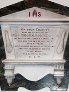 "View of cut-white marble Classical-style wall monument (ob. 1874) dedicated: ""+/IHS/OF YOUR CHARITY/Pray For The Soul Of The/REVd. THOMAS HARDIMAN/The Zealous And Learned P.P. Of Ballinrobe/Who Died The 10th Of Nov. 1874/Aged -- Years/Whose Remains Are Buried In This Church/Where An Altar Is Erected/To His Memory/By A Grateful People/R.I.P.""."