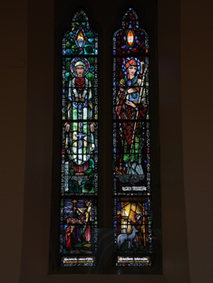 "View of Staunton Memorial Window supplied (1925) by Harry Clarke (1889-1931) of Dublin depicting ""S. Gormgail"" and ""S. Keiran [sic]"" dedicated: ""Erected to the memory of John & Bridget Staunton by their son John"".  Photography by James Fraher"