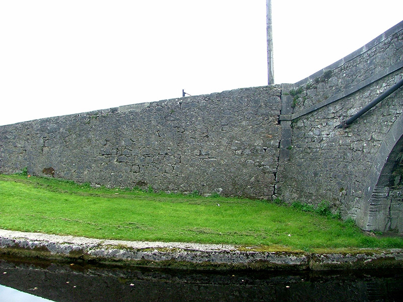 Flanking wall to north-east