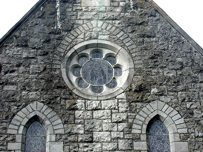 Detail of rose window to entrance gable