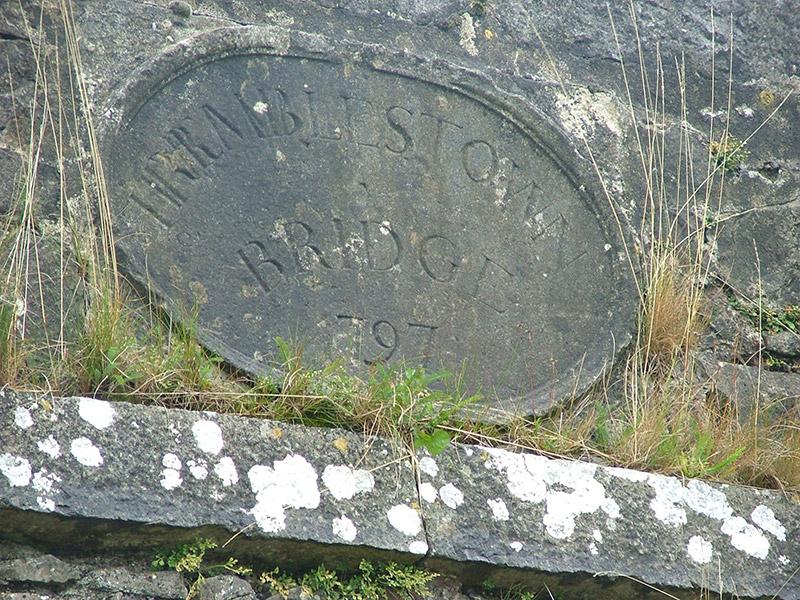 Date plaque to parapet