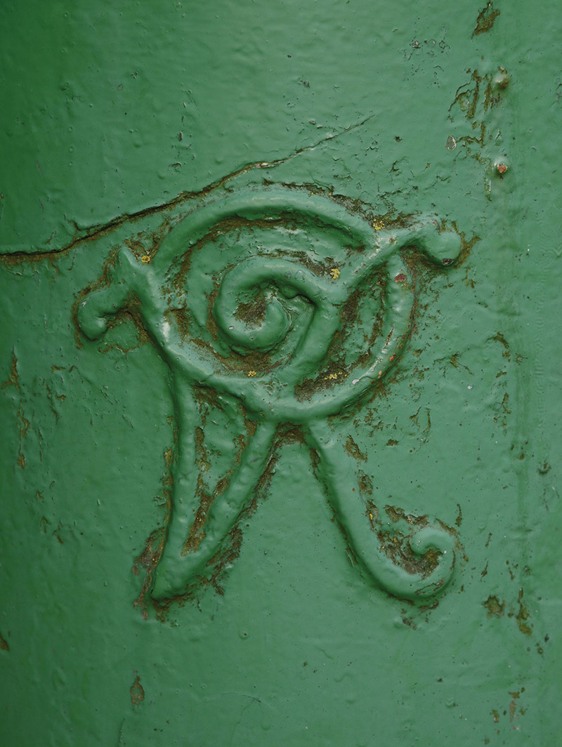 """Detail of post box embossed: """"VR [Victoria Regina]"""".  Photography by James Fraher"""