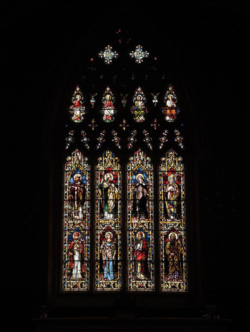 """View of Feeny Memorial """"East Window"""" (ob. 1873) signed by Franz Mayer and Company (founded 1847) of Munich and London depicting (top) """"Saint Lawrence O'Toole""""; """"Saint Patrick""""; """"Saint Bridget"""" and """"Saint Kevin"""" and  (bottom) """"Saint Muredock""""; """"Saint Dympna""""; """"Saint Asicus"""" and """"Saint Columbkill"""" dedicated: """"In Memoriam Reverend Thomas Feeny Epi Alladensis 1839-73 RIP/Mayer And Company Munich And London [studio signature]"""".  Photography by James Fraher"""