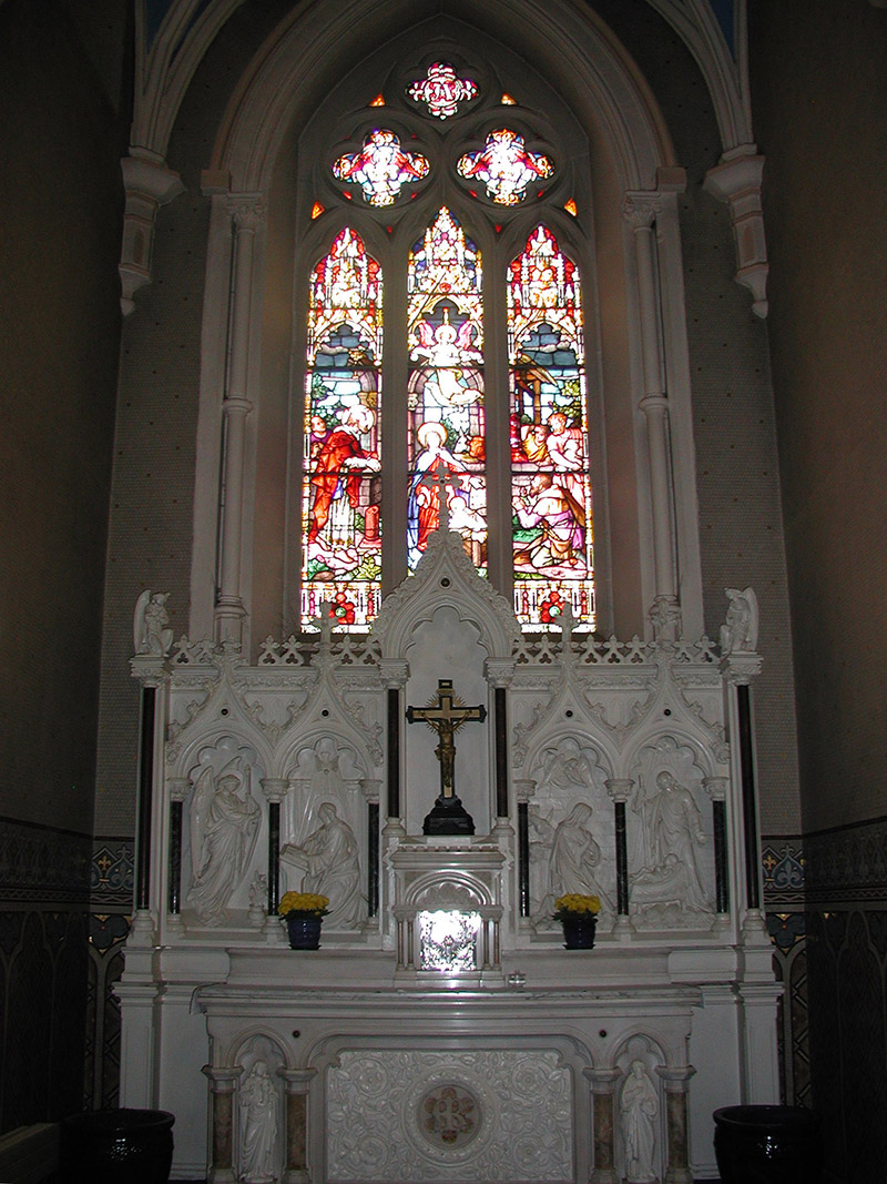 """View of interior including view of ???? Memorial Window (????) by ???? (????) of ???? depicting """"The Nativity"""" dedicated: """"????""""."""