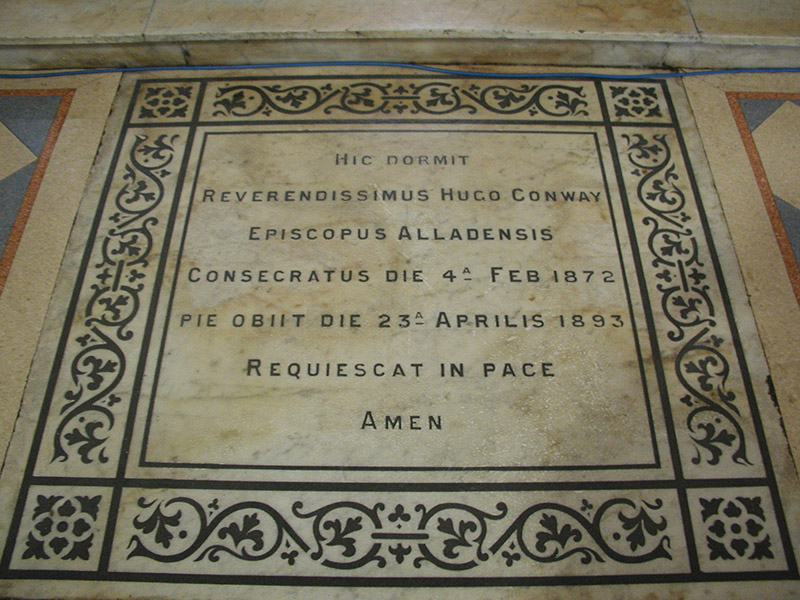 """View of inlaid cut-white marble floor monument (ob. 1893) dedicated: """"Hic Dormit/Reverendissimus Hugo Conway/Episcopus Alladensis/Consecratus Die 4a Febbraio 1872/Pie Obiit Die 23a Aprilis 1893/Requiescat In Pace/Amen""""."""