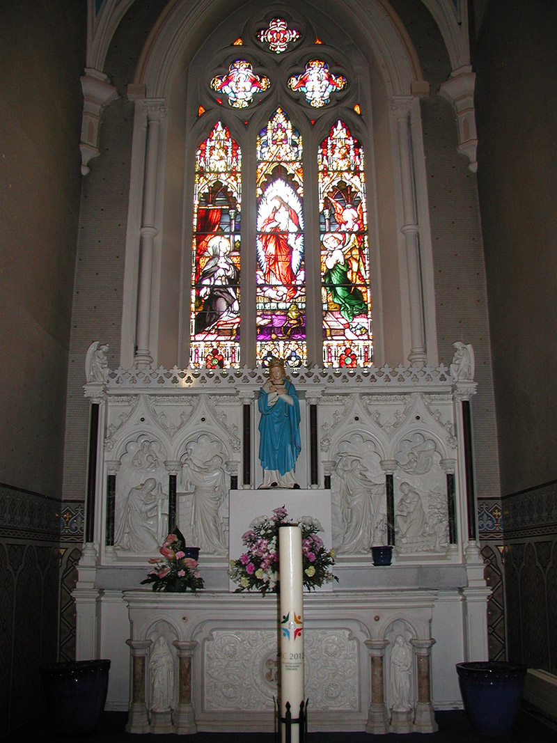 """View of interior including view of ???? Memorial Window (????) by ???? (????) of ???? depicting """"The Sacred Appears to ????"""" dedicated: """"????""""."""