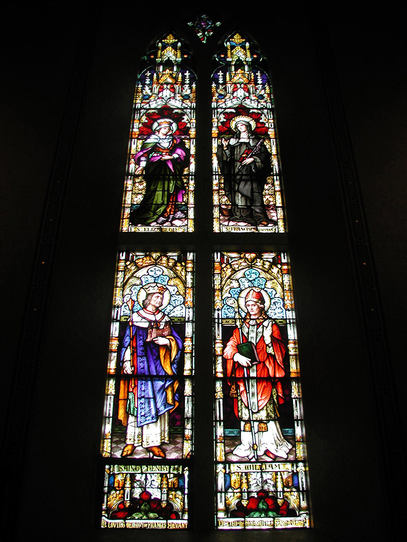 """View of Devany Memorial Window (1893) by ???? (????) of ???? depicting (top) """"Saint Elizabeth"""" and """"Saint Francisca [sic] Romana"""" and (bottom) """"Saint Henry"""" and """"Saint William"""" dedicated: """"In Loving Memory Of Francesca Devany Erected By Her Brother Henry AD 1893""""."""
