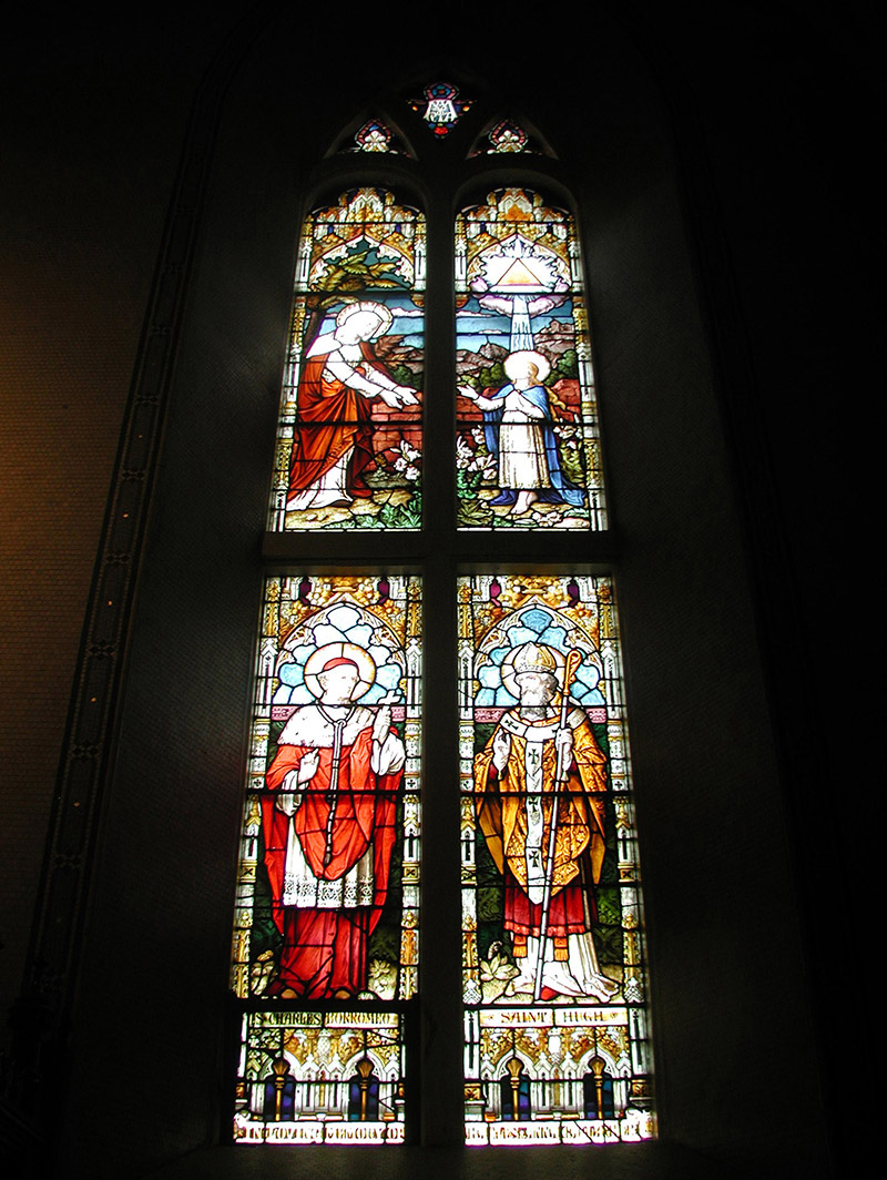 """View of Gallagher Memorial Window (undated) by ???? (????) of ???? depicting (top) """"????"""" and (bottom) """"Saint Charles Borromeo"""" and """"Saint Hugh"""" dedicated: """"In Loving Memory Of Charles And Anne Gallagher""""."""