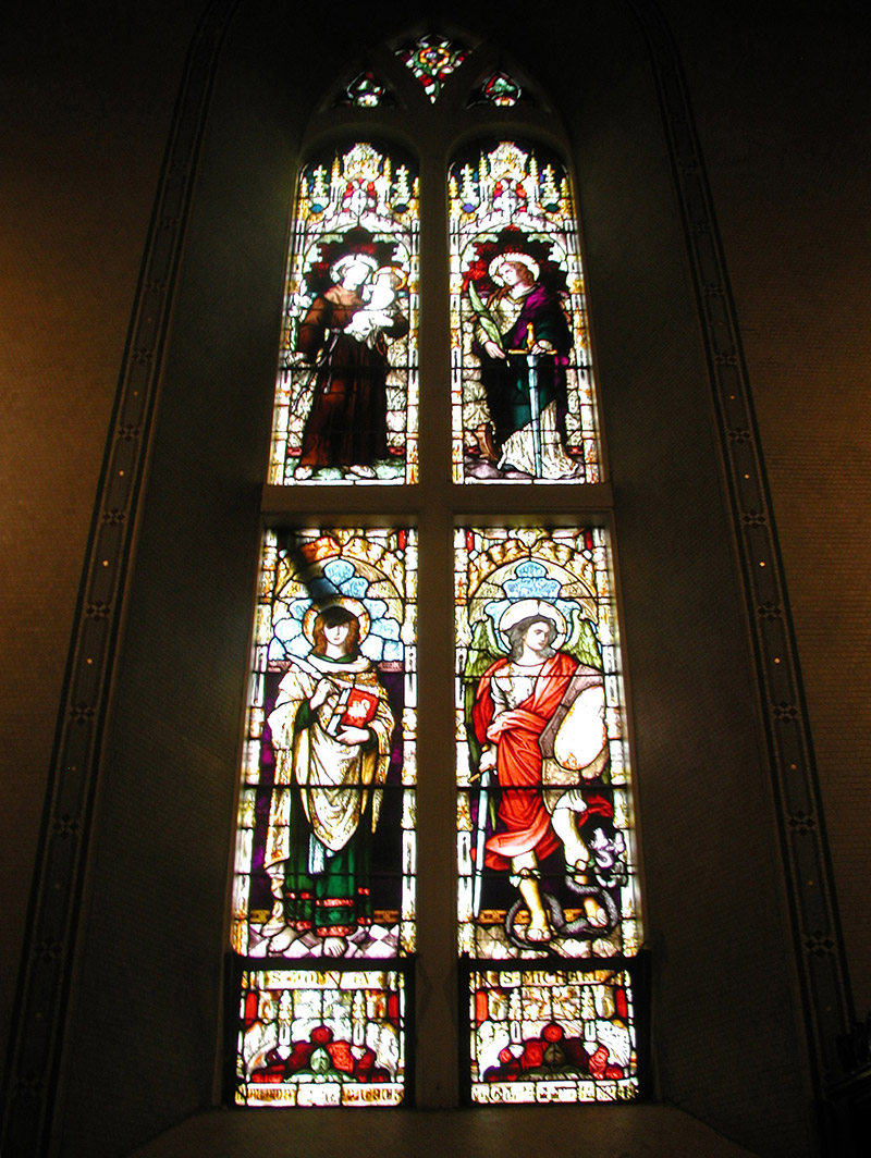 """View of MacHale Memorial Window (ob. 1887) by ???? (????) of ???? depicting (top) """"????"""" and """"????"""" and (bottom) """"Saint John the Evangelist"""" and """"Saint Michael"""" dedicated: """"In Memory Of Reverend Patrick MacHale PP Died January 22nd 1887 AM MM""""."""
