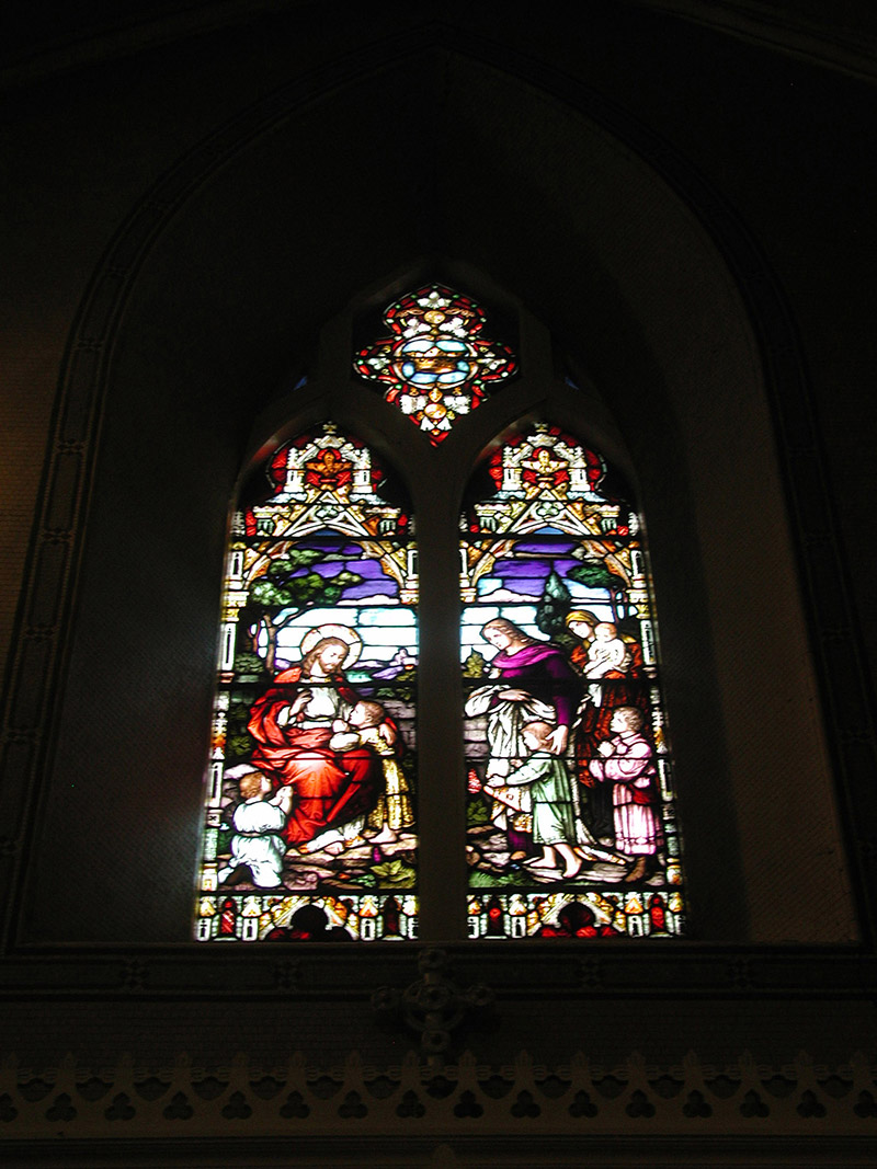 """View of Coolican Memorial Window (????) by ???? (????) of ???? depicting """"Christ Blessing the Children"""" dedicated: """"In Memory Of James Coolican ???? RIP""""."""
