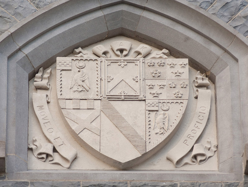 """View of cut-sandstone shield coat of arms inscribed: """"UAK [Utred Augustus Knox]/MOVEO ET PROFICIO [I Proceed And Prosper]"""".  Photography by James Fraher"""