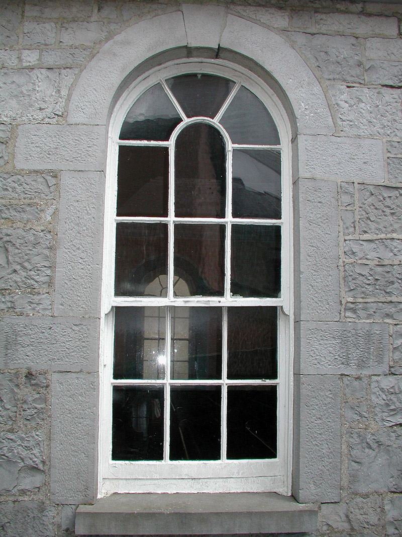 Timber sash window to side wall of nave